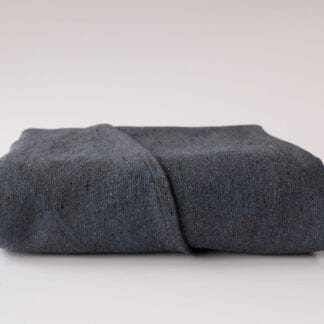 Disguise. A deep blue- and grey wrap made from 38% organic cotton 37% Silk, 25% wool and has a gsm of 310.
