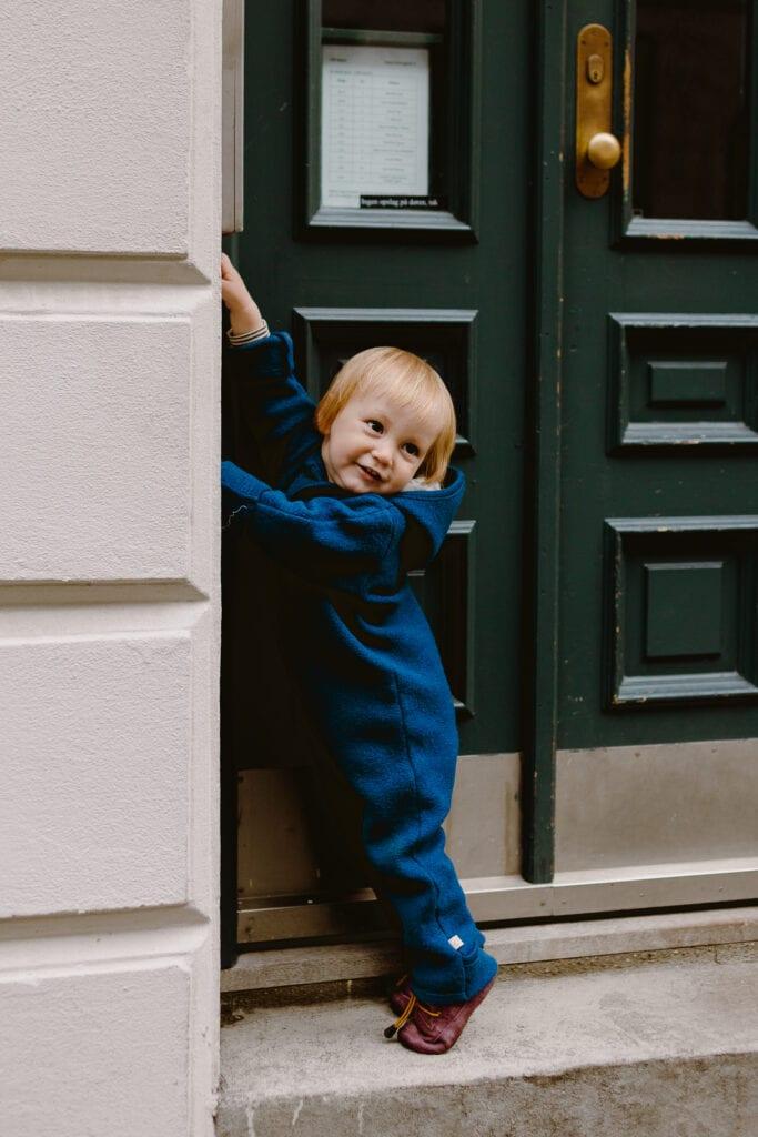 A toddler boy pushing the